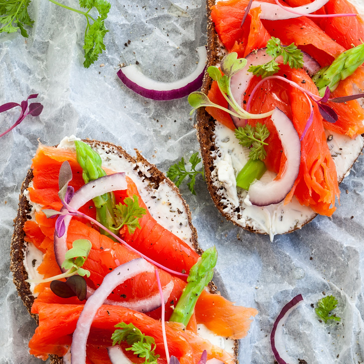Vibrant-colored Sockeye lox slices mixed into tasty appetizers.