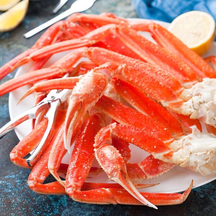 A fresh pile of bright Alaska snow crab legs.