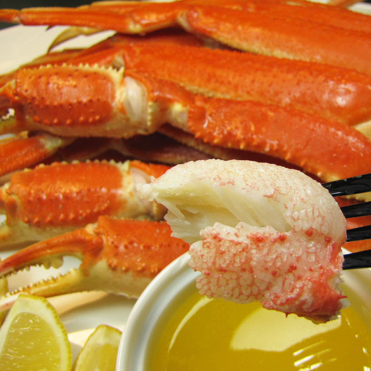 Fresh giant Alaska snow crab with lemons & melted butter.