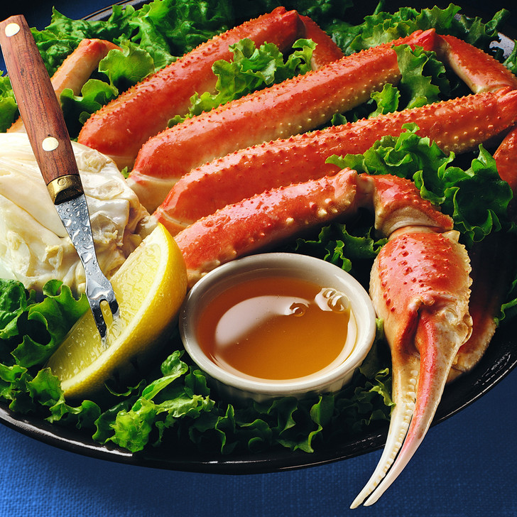 Giant Alaska snow crab legs on a bed of lettuce.