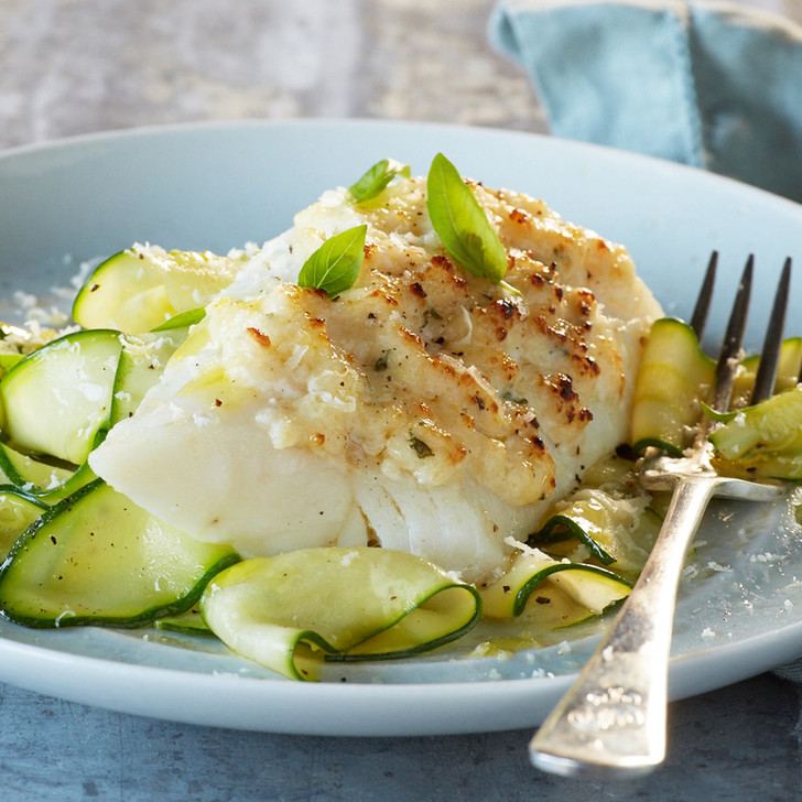 Baked wild Alaska cod fillet with zucchini noodles.