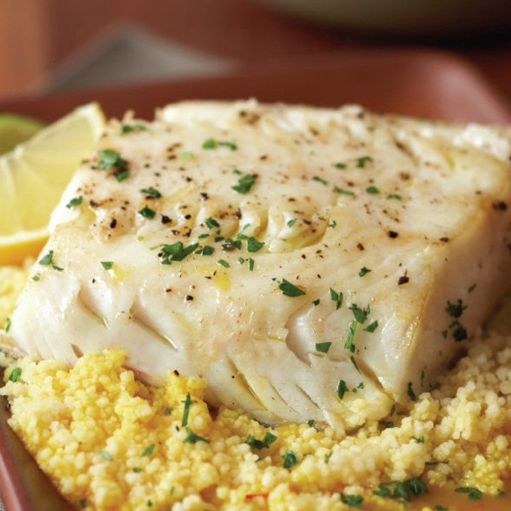 A delicious black cod fillet portion on a bed of couscous.