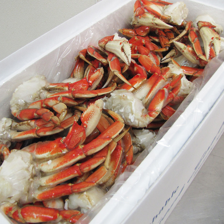 A case of Alaska Dungeness crab legs & claws.