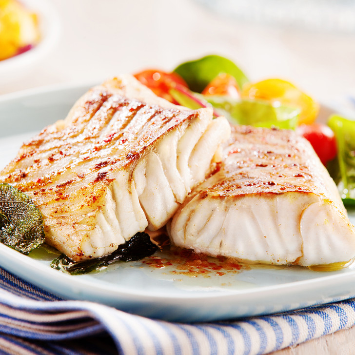Two broiled cod fillet portions with tomato medley.