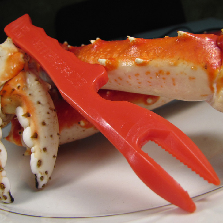An EZ shelling tool propped on some king crab legs.