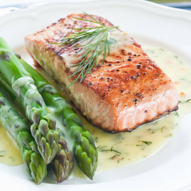 a delicious king salmon fillet alongside a pile of fresh asparagus.