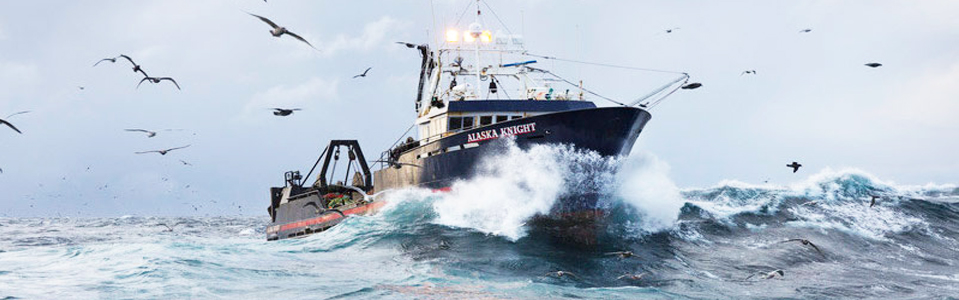 King crab fishing boat on high waves