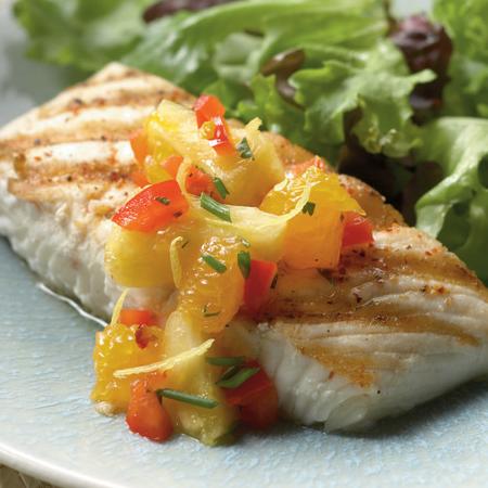 Grilled Alaska halibut fillet with chopped fruit on top