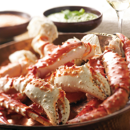 Steamed Alaska red king crab legs and claws with dipping sauces