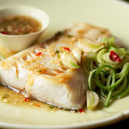 A flaky fillet of pan-cooked black cod drizzled with ginger-lime sauce