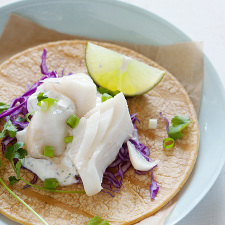 Poached Alaska cod on a tortilla with cilantro & lime