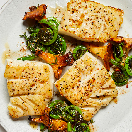Buttery spiced cod fillets with fiddlehead ferns and mushrooms