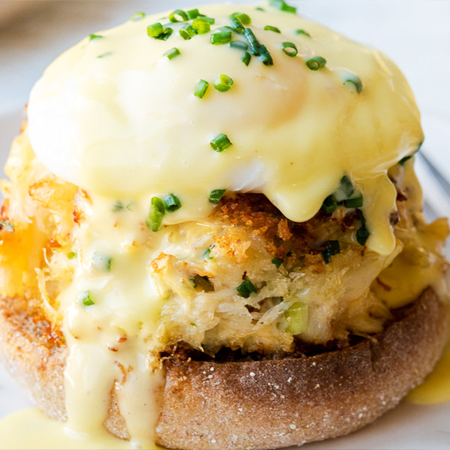 A dungeness crab cake on English muffin smothered in Hollandaise sauce