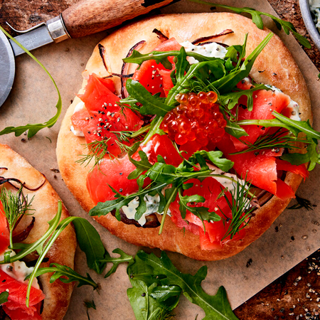 Delicious pizzettes topped with smoked salmon & salmon roe