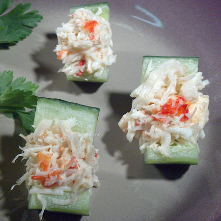 Cucumber halves filled with snow crab mixture