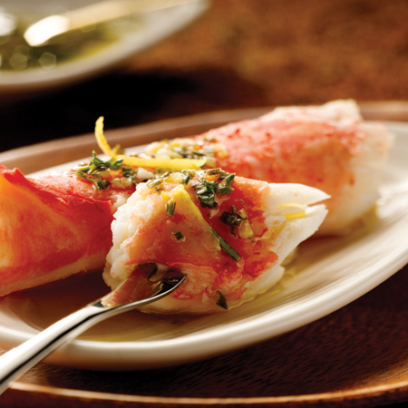 Steamed king crab with drizzled with Chardonnay lemon herb splash
