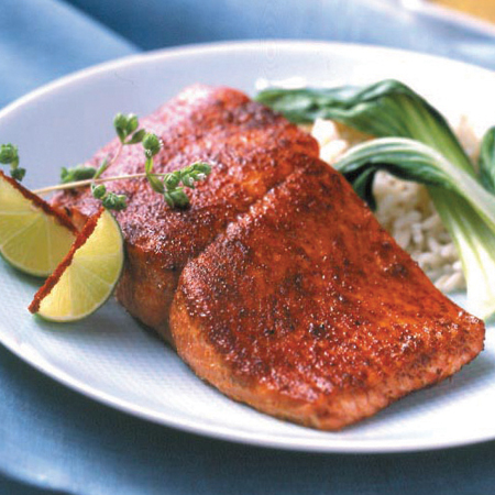 A charred sugar-crusted salmon fillet with limes & bok choy