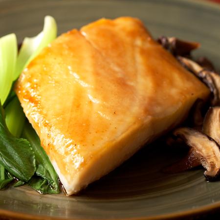 A glazed fillet of Alaska black cod with bok choy and mushrooms