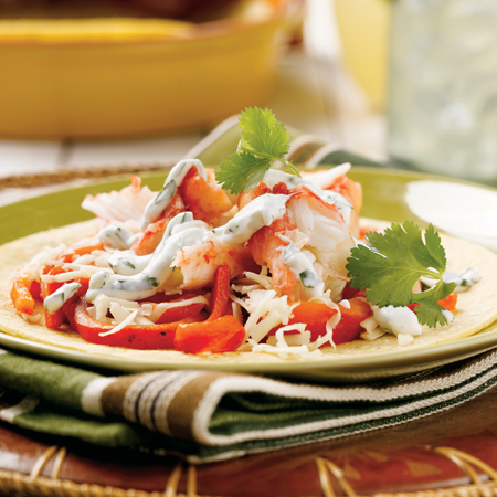 A mix of snow crab meat, peppers, & sour cream mix on a tortilla