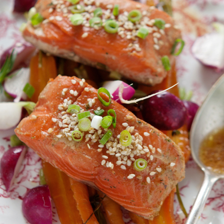 Sockeye salmon fillets drizzled with Shoyu tarragon sauce and sprinkled with sliced green onions & sesame seeds