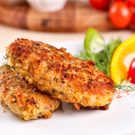 Crispy golden crab cakes with garnishes