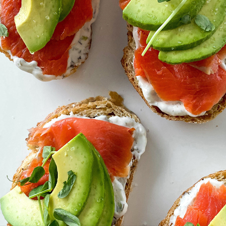 Delicious smoked salmon appetizers with sliced avocados on top