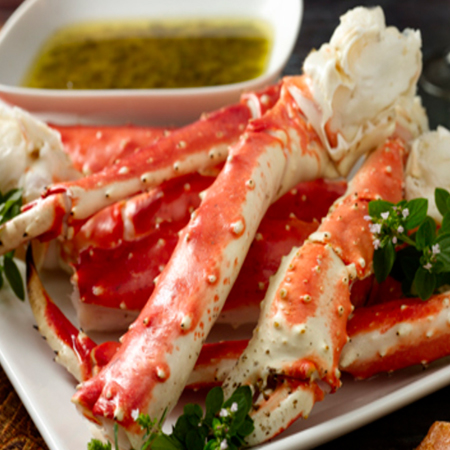 Alaska king crab legs with butter-herb dipping sauce