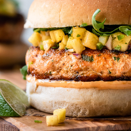 A delicious & juicy Thai style salmon burger with pineapple salsa