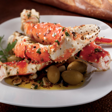 Large king crab legs with green olives