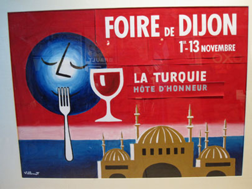 Foire De Dijon (Original Maquette) by Bernard Villemot from 1952 France. Horizontal French food poster features a blue moon over the water and red sky near a domed building with a fork up to its mouth and glass of wine next to him.