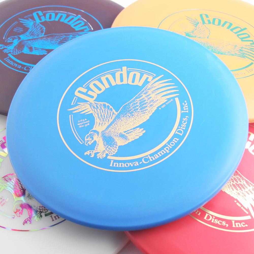 Innova DX CONDOR *Choose Options* Wide Diameter Approach Golf Disc - Spread on table