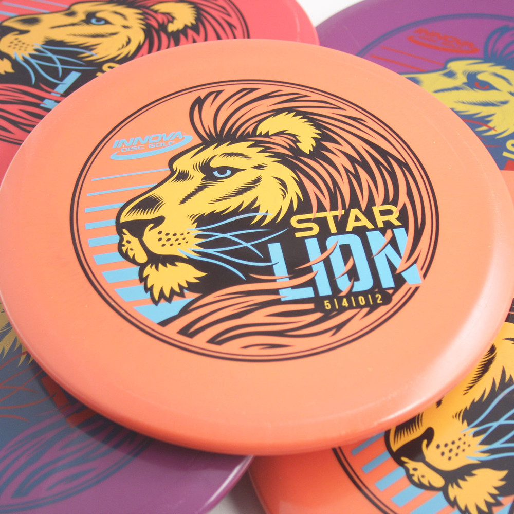 Innova STAR LION - INNFUSE GRAPHICS Mid-Range Golf Disc - view of many color variation spread on table