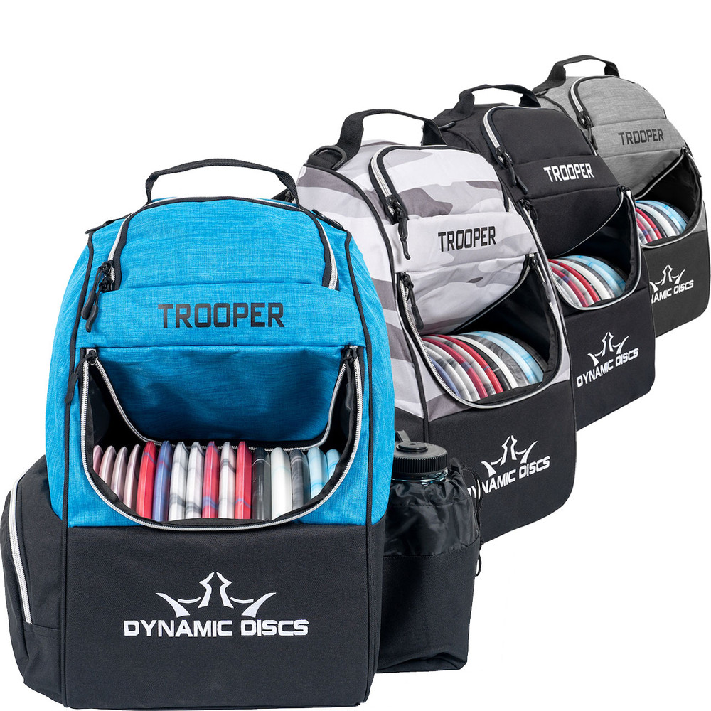 Dynamic Discs TROOPER BACKPACK Bag for Disc Golf - four color options of the bag lined up in a row with the blue and black one facing forward, flap open showing discs inside.