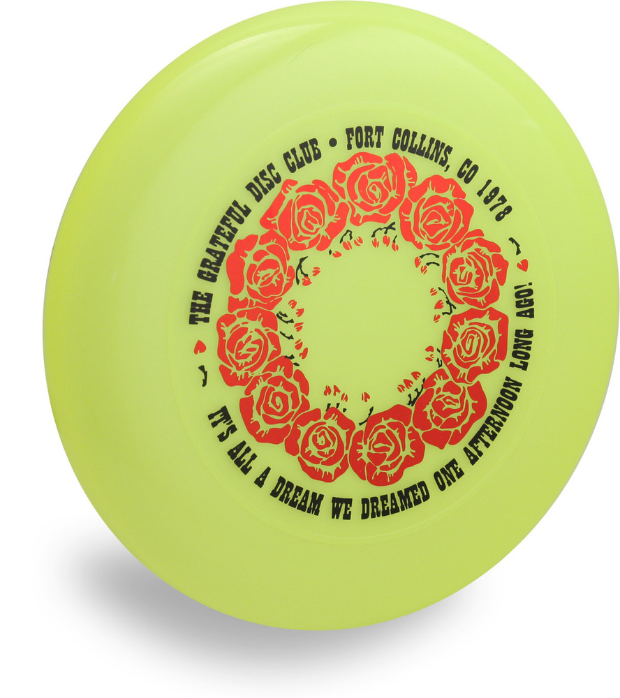 "DISCRAFT SKY STYLER FREESTYLE DISC - CUSTOM GRATEFUL DISC ROSES - angled top view of yellow disc with red ring of roses and words: ""The Grateful Disc Club - Fort Collins, CO 1978 - It's All a Dream We Dreamed One Afternoon Long Ago!"""