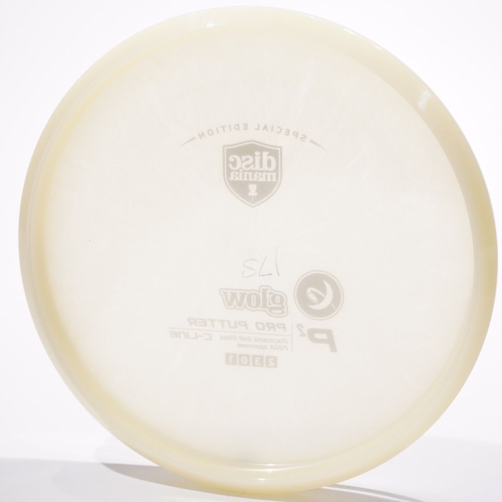 Discmania Glow C-Line P2. Shows bottom view of a white glow plastic disc  standing vertically at a slight angle with a white background.