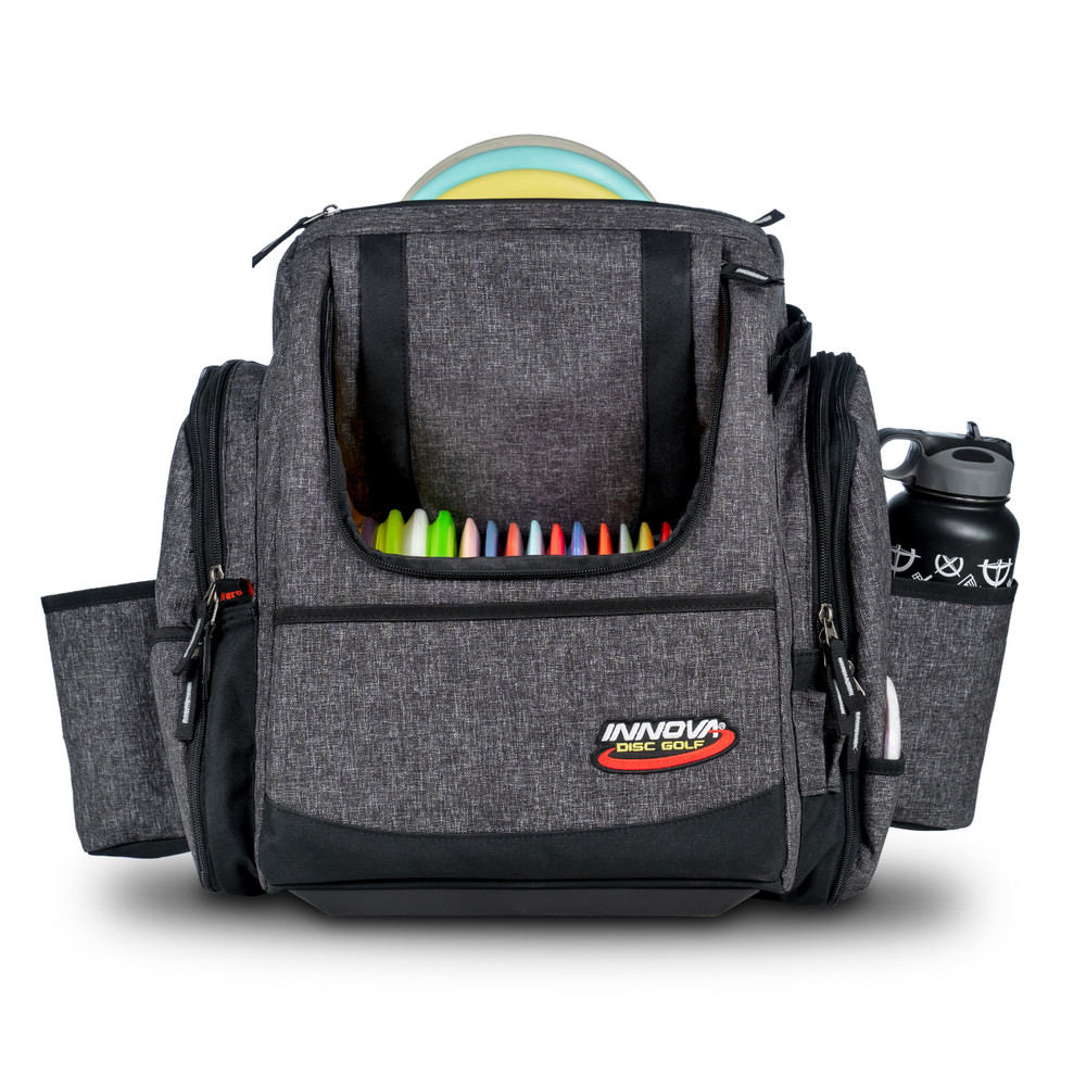 Shows front view of the Innova Super HeroPack II in Black Heather color. The front flap is open showing a full load of discs and a water bottle appears in the side pocket. A disc is sticking up from the top slightly.