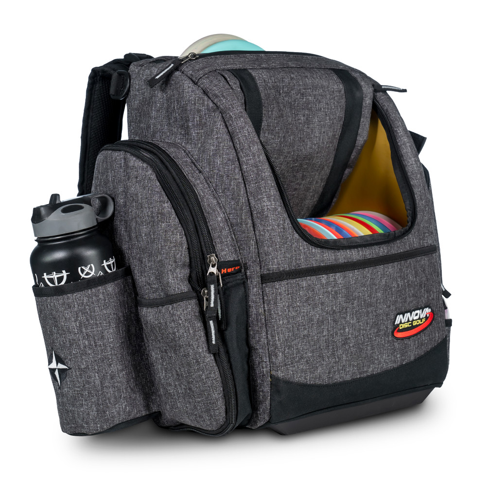 Shows angled front view of the Innova Super HeroPack II in Black Heather color. The front flap is open showing a full load of discs and a water bottle appears in the side pocket. A disc is sticking up from the top slightly.