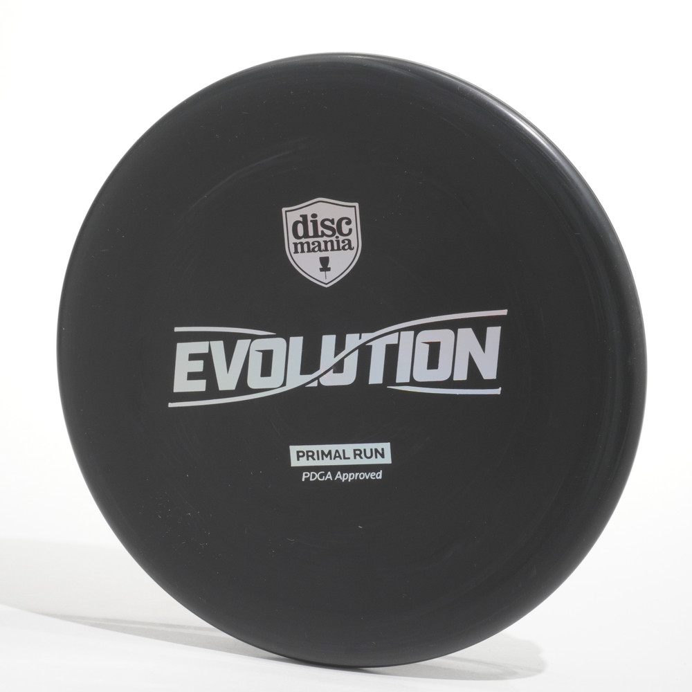 Top view of a black Discmania Evolution Tactic (Exo Soft) Primal Run with a silver prism foil stamp.