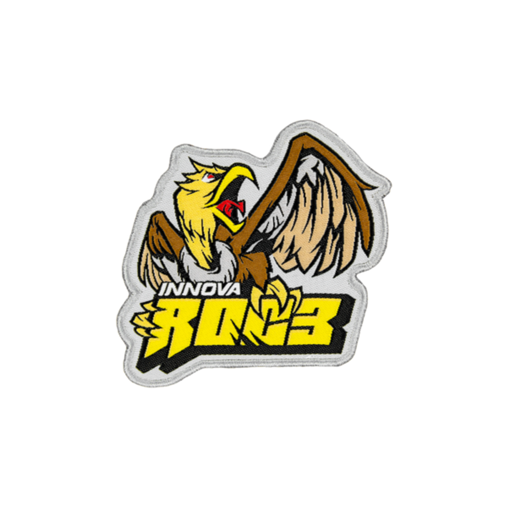 "A patch is shown that says ""Innova"" in white and ""Roc3"" in blocky yellow lettering with a brown and yellow bird sitting on top of the lettering."