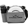 Front view of heathered gray Dynamic Discs Cadet starter bag. Shows water bottle in pocket on side to viewer's left, white disc in front pocket, and a single strap. Has black Dynamic Discs logo on front.