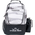 Dynamic Discs TROOPER BACKPACK Bag for Disc Golf - half arctic camo and half black bag, front view, with disc pocket closed