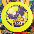 Innova STAR EAGLE - INNFUSE Design. Top view of five discs of different colors spread out and overlapping. A yellow disc is centered in the frame. It has a purple, red and white graphic of an eagle with a snake in its claws.