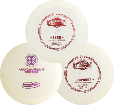Innova Glow Champion Set - 3 Drivers Pack. Shows three discs arranged in a triangle and overlapping each other. The top disc is an Innova Glow Tern, the bottom two are the Innova Glow Archon and the Innova Glow Leopard3