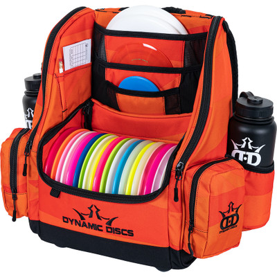 Dynamic Discs COMMANDER BACKPACK Disc Golf Bag -  Infrared Orange color. Shows a fully-loaded Commander bag with full capacity of discs, putters in the upper pockets and water bottles in the side compartments.