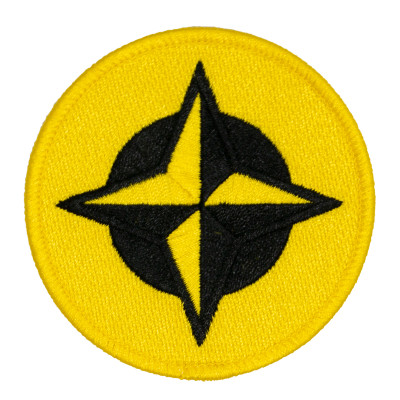 Innova Proto Star Patch. Shows a round patch with black and yellow four point star with a black and a yellow circle behind it.