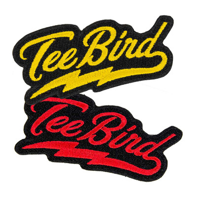 """Two patches are shown spread out vertically and overlapping slightly. They both say """"TeeBird"""" in cursive lettering with a lightning bolt curl underlining the word that comes off of the letter d. The top one is yellow, the bottom is red."""
