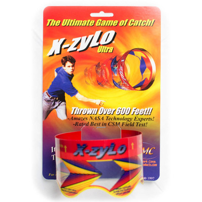 "X-ZYLO FLYING GYROSCOPE Amazing Fun Flying Science Toy - picture of front of package showing the toy itself near the bottom. Packaging says, ""The Ultimate Game of Catch! X-zylo Ultra. Thrown over 600 feet!! Amazes NASA Technology Experts! Rated Best in CSM Field Test!"""