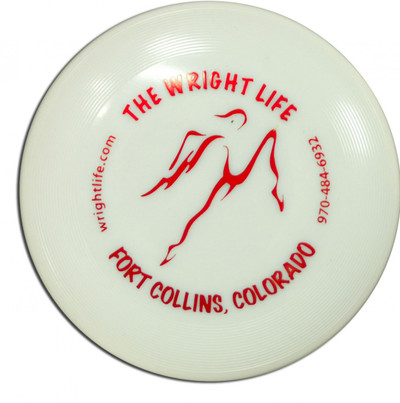 WHAM-O WRIGHT LIFE GLOW MINI - top view of disc made of whitish glow material with a red The Wright Life stamp.