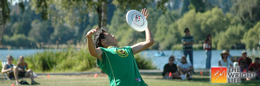 A person performing a chest roll freestyle frisbee maneuver