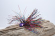 Purple Glitter Jig Head with a Rainbow Tinsel Mix